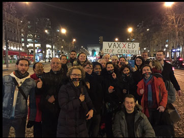 Crowd in France Vaxxed Censored stickers over mouths